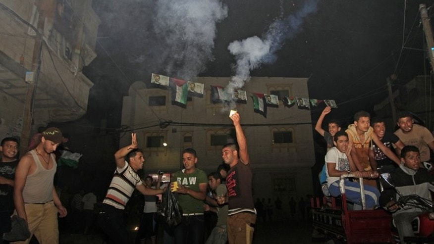 Fans of Mohammad Assaf celebrate in Khan Yunis after the Palestinian singer won the final of the Arab Idol competition on June 22, 2013. Tens of thousands of jubilant Palestinians celebrated into the early hours of Sunday after the Gazan singer won the prestigious Arab Idol talent show that has captivated millions across the Middle East since March.