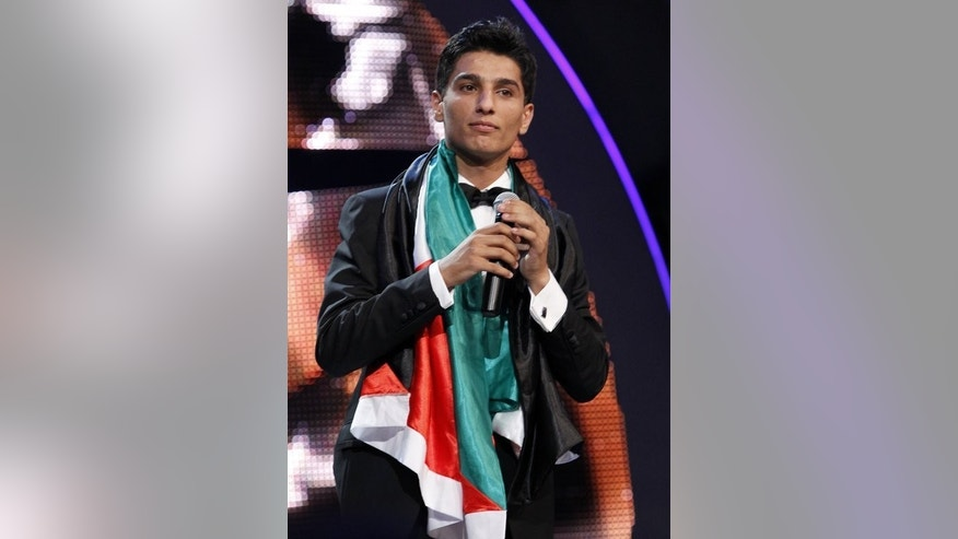 "Palestinian singer Mohammed Assaf performs after winning the ""Arab Idol"" singing contest in Beirut, on June 23, 2013. Jubilant Palestinians took to the streets in their thousands after Assaf won the pan-Arab singing contest that has had millions of viewers fixed to their TV screens since March."
