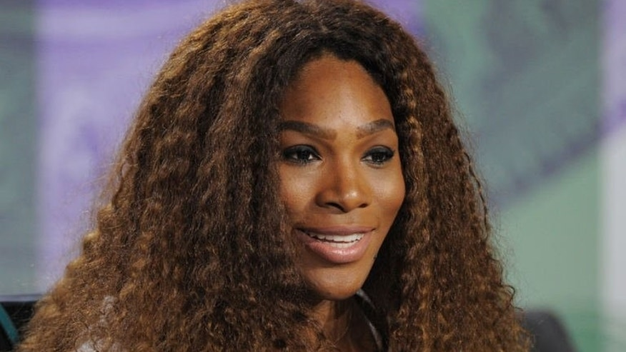 US tennis player Serena Williams attends a news conference at the All England Tennis Club in Wimbledon, London, on June 23, 2013. Williams tried to defuse her war of words with Maria Sharapova as the Wimbledon champion claimed she had apologised to the Russian for criticising her private life.