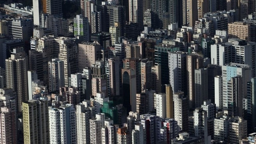 A view of residential and commercial buildings in Hong Kong, on June 23, 2013. Hong Kong has risked the threat of US reprisals in allowing Edward Snowden to leave but its government insists that the rule of law took primacy for a territory that jealously guards its separateness from mainland China.