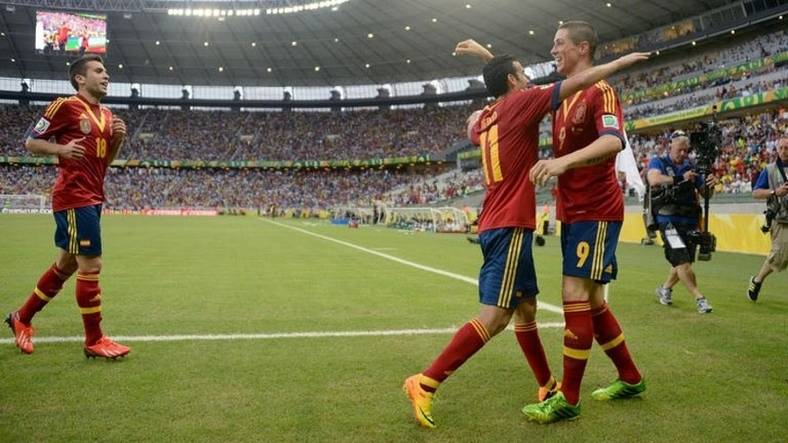 Spain's forward Fernando Torres (R) celebrates with teammates Pedro (C) and Jordi Alba after scoring against Nigeria during their FIFA Confederations Cup Brazil 2013 Group B football match, at the Castelao Stadium in Fortaleza on June 23, 2013. Spain won 3-0.