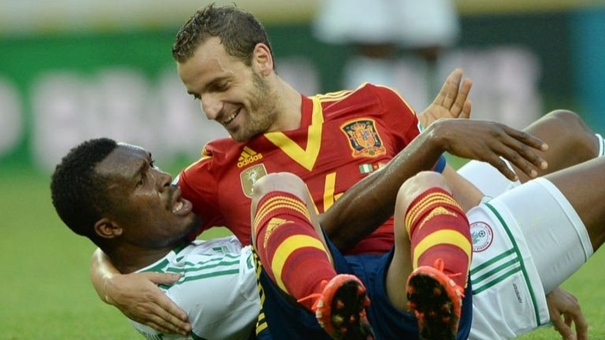 Spain's forward Roberto Soldado (top) and Nigeria's defender Azubuike Egwuekwe are pictured during their FIFA Confederations Cup Brazil 2013 Group B football match, at the Castelao Stadium in Fortaleza on June 23, 2013. Spain won 3-0.