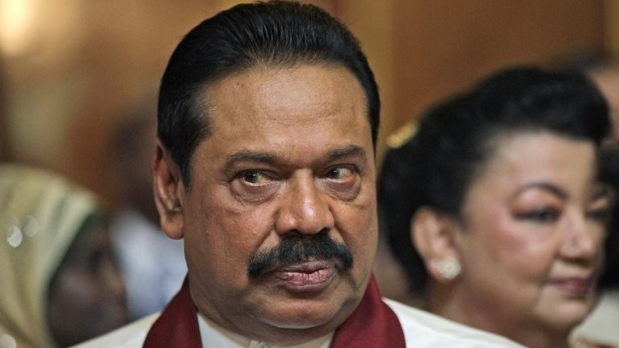 Sri Lankan President Mahinda Rajapaksa attends a reception in London, on June 6, 2012. Rajapakse has scrapped a contentious code of conduct for journalists after editors and rights groups condemned it as a further blow to press freedom, government and media sources told AFP.