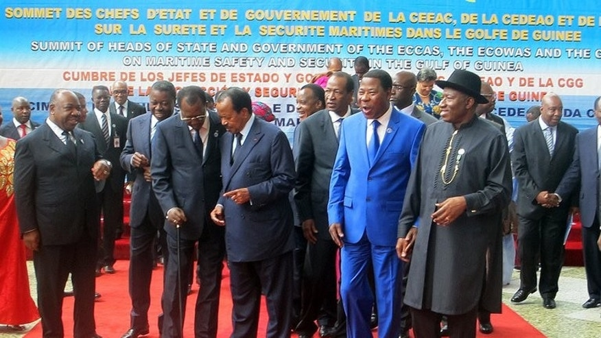 (From L) The presidents of Gabon Ali Bongo Ondimba , Togo Faure Gnassingbe, Chad Idriss Deby Itno, Cameroon Paul Biya, Congo Denis Sassou Nguesso, Burkina Faso Blaise Compaore, Benin Thomas Yayi Boni and Nigeria Goodluck Jonathan prepare for a group picture in Yaounde at a meeting of West and Central African leaders on maritime security in the Gulf of Guinea, on June 24, 2013.