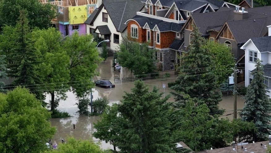 The Bow River floods a neighbourhood in Calgary, Alberta, Canada on June 22, 2013. Flood damage was estimated in the billions of dollars Monday as residents of the Canadian city of Calgary and other districts began mopping up after deadly floods which killed three people and forced 100,000 to flee.