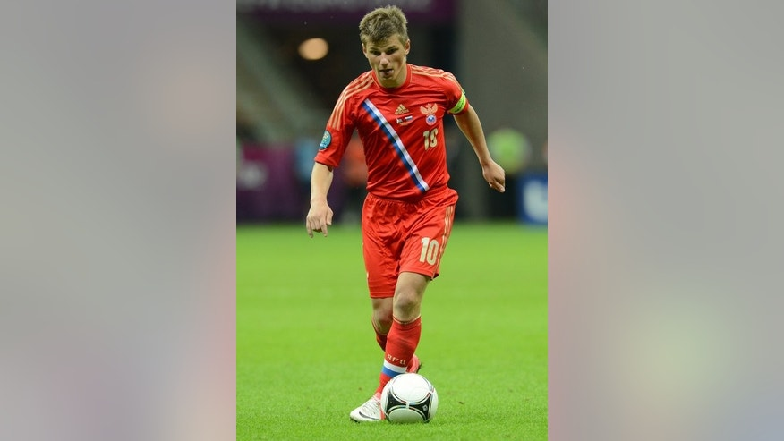 Andrey Arshavin plays for Russia against Greece in Warsaw in June last year during the Euro 2012 championships. The Sport Express daily said that Arshavin's move back to Zenit could be announced later Monday after he won the backing of the club's owner, the gas giant Gazprom.