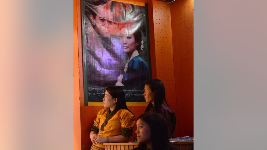 "Employees of a karaoke bar watch others perform on stage, in Thimphu, on June 2, 2013. It is known as ""the last Shangri-La"" -- a remote Himalayan nation, rich in natural beauty and Buddhist culture, where national happiness is prioritised over economic growth."