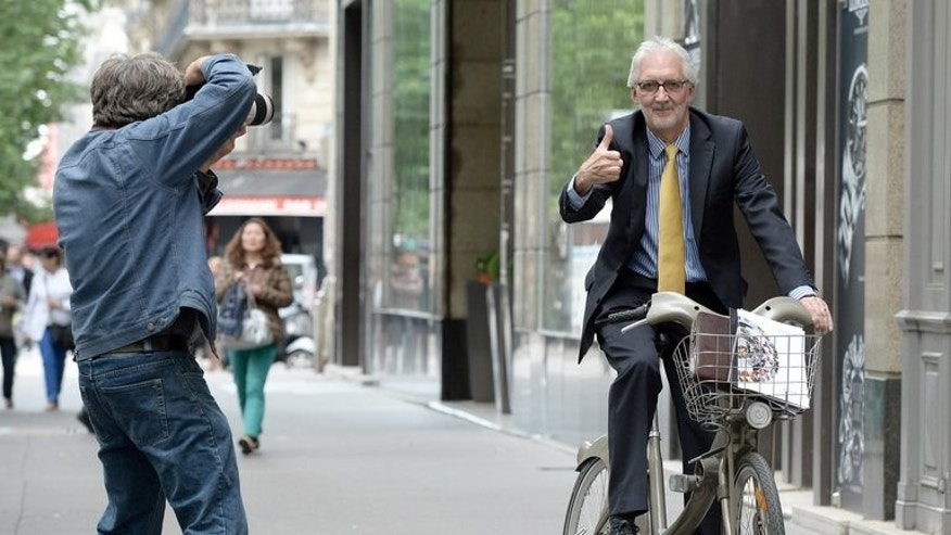 British Cycling chief Brian Cookson rides a bicycle in Paris, on June 24, 2013. Cookson is challenging controversial incumbent Pat McQuaid for the presidency of the International Cycling Union (UCI).