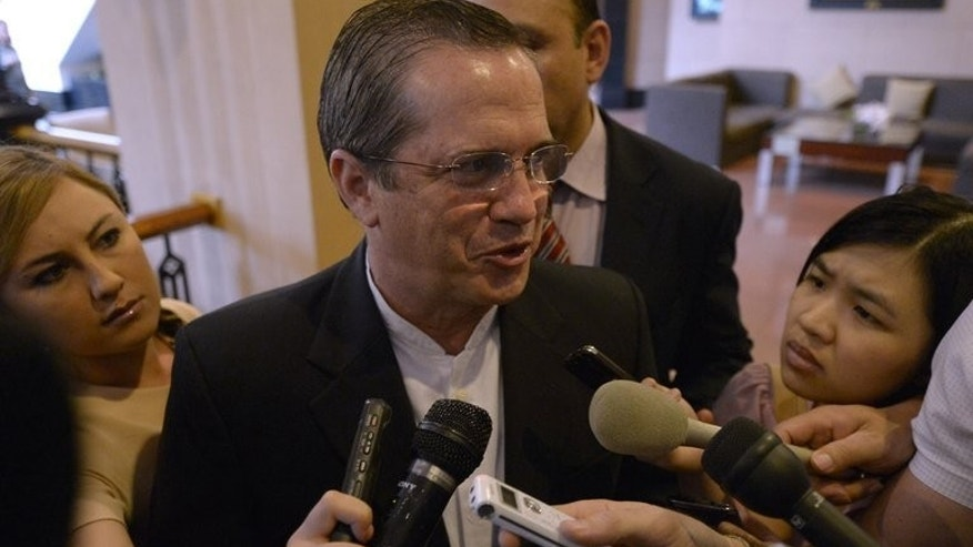 "Visiting Ecuador Foreign Minister Ricardo Patino talks to reporters as he leaves a hotel in Hanoi on June 24, 2013. He said his country was ""analysing"" a request for asylum by fugitive US intelligence leaker Edward Snowden who is currently in Moscow."