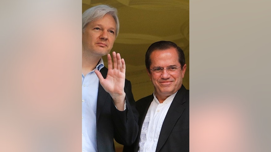 "Ecuadorian Foreign Minister Ricardo Patino (R) and Wikileaks founder Julian Assange at the Ecuadorian embassy in central London on June 16, 2013. Patino, speaking during a visit to Vietnam, praised Snowden's actions, saying the 30-year-old fugitive was trying to ""shed light and transparency"" on US practices."