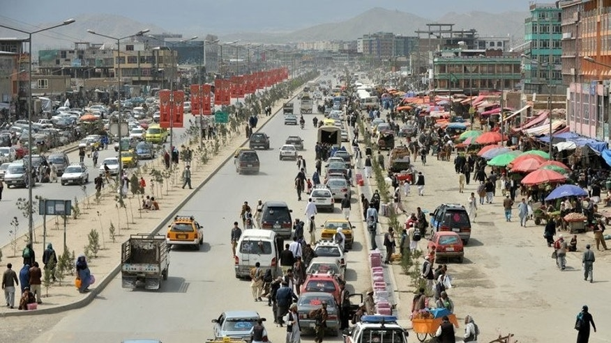 In a picture taken on April 22, 2013, vehicles ply the streets of Kabul. Explosions and gunfire erupted in Kabul, with police confirming a militant attack in the centre of the Afghan capital but unable to give further details.