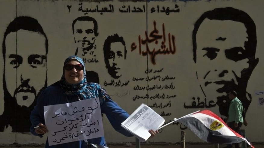 A woman collects signatures to demand the ouster of Egyptian President Mohamed Morsi, in Cairo, on May 17, 2013. The campaign, dubbed Tamarod (rebellion in Arabic), collected more than 15 million signatures in support of a snap presidential election just a year after Morsi took power.