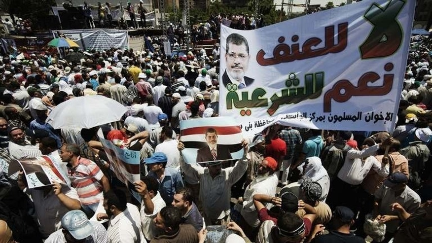 Islamist groups led by the ruling Muslim Brotherhood show their support for President Mohamed Morsi, on June 21, 2013, in Cairo. Morsi's supporters say he is an elected president who is working to root out decades of corruption in state institutions.