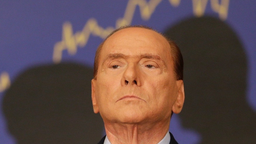Sept. 27 2012 - FILE photo of former Italian premier Silvio Berlusconi attends the presentation of a book  in Rome.