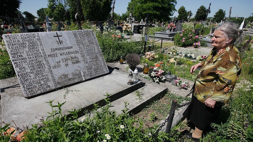 June 19, 2013 - A mass grave and a monument in the village of Chlaniow, Poland, holding the bodies of Poles killed in an attack on the village by the Nazi SS-led Ukrainian Self Defense Legion in 1944.  44 villagers and a visitor were killed. An investigation by the AP revealed that a commander in the legion, Michael Karkoc, 94, is living in the United States. In his Ukrainian-language memoirs Karkoc said he was in Chlaniów at the time of the attack. None of the records uncovered by the AP links him directly to atrocities.