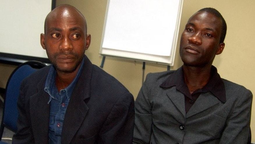 "Tiwonge Chimbalanga (R), and his gay partner Steven Monjeza are seen in Liongwe, on June 2, 2010, five days after Malawi's President Bingu wa Mutharika pardoned them. Malawi drew worldwide condemnation for the jailing of the couple for 14-years with hard labour for sodomy. During the course of the trial, Mutharika called homosexuality ""evil and very bad before the eyes of God""."