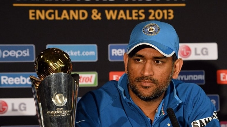 Indian captain Mahendra Sing Dhoni listens to questions during a press conference at Edgbaston in Birmingham, England on June 22, 2013. Winners India provided five players in the Champions Trophy team of the tournament announced by the International Cricket Council (ICC) on Monday.