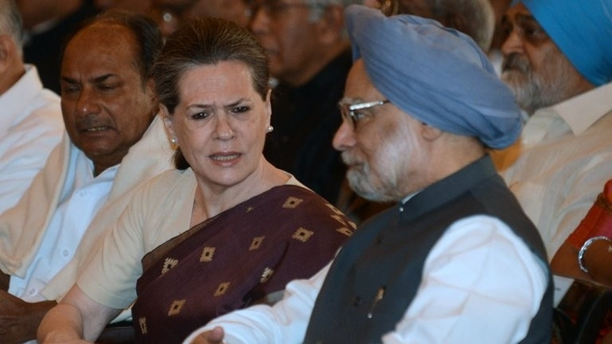 This file photo shows India's Congress Party president Sonia Gandhi (C) speaking with Prime Minister Manmohan Singh, in New Delhi, on October 28, 2012. Singh was to pay a landmark visit to troubled Indian Kashmir on Tuesday, a day after heavily-armed militants killed eight soldiers in the deadliest attack in the region for five years. Singh was to be accompanied by Gandhi.
