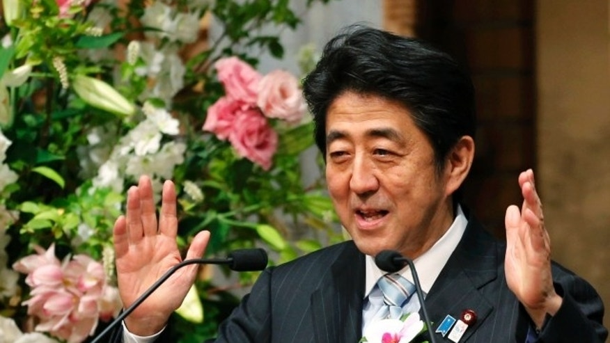 "Japan's Prime Minister, Shinzo Abe, delivers a speech at a dinner during the 19th International Conference on ""The Future of Asia"" in Tokyo on May 23, 2013"