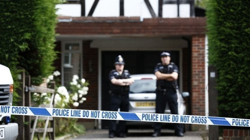 File picture shows police stand outside the home of Saad and Iqbal al-Hilli in Claygate in Surrey, south-east England, on September 14, 2012 at the start of the investigation into their killing along with two other people in the French Alps. British police said Monday they had arrested a 54-year-old man in connection with the murders of three members of the family and a French cyclist.