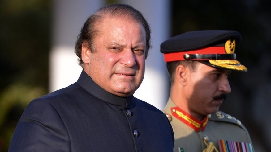 Pakistan's Prime Minister, Nawaz Sharif, arrives to inspect a guard of honour in Islamabad, on June 5, 2013. Sharif called on Monday for former military ruler Pervez Musharraf, who is currently under house arrest, to face trial for treason.