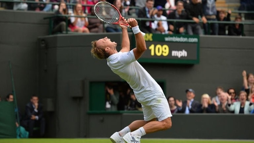 Belgium's Steve Darcis celebrates beating Spain's Rafael Nadal during their men's first round match on day one of the 2013 Wimbledon Championships tennis tournament at the All England Club in Wimbledon, southwest London, on June 24, 2013. Darcis won 7-6, 7-6, 6-4.