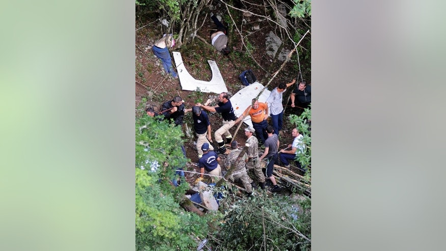 Montenegran rescue workers at the scene of a bus accident near Grlo, on June 23, 2013.