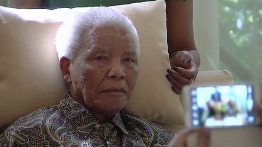 April 29, 2013 - FILE image taken from video of ailing anti-apartheid icon Nelson Madela more than three weeks after being released from a hospital.