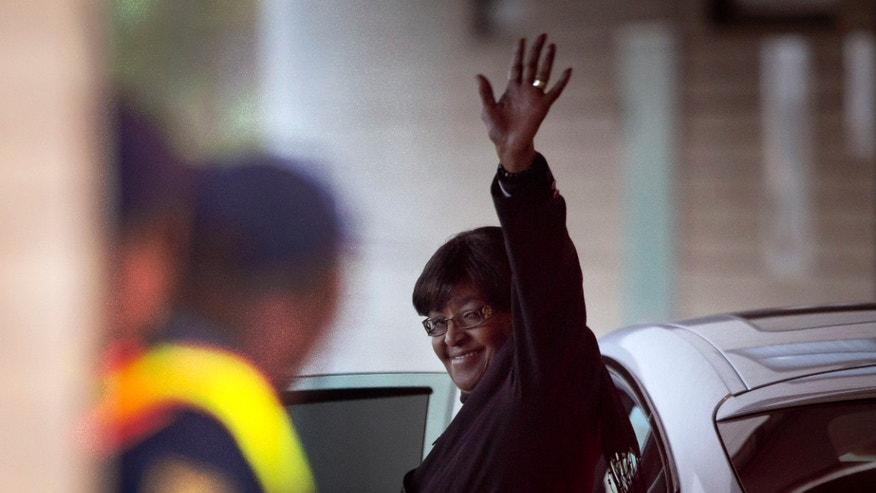 June 24, 2013 - Former wife Winnie Madikizela-Mandela waves to the media as she leaves after visiting the Mediclinic Heart Hospital where former South African President Nelson Mandela is being treated in Pretoria, South Africa.
