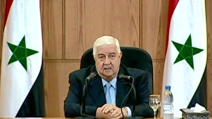 A handout picture released by the Syrian Arab News Agency (SANA) shows Syrian Foreign Minister Walid Muallem speaking during a televised press conference in Damascus, on June 24, 2013.