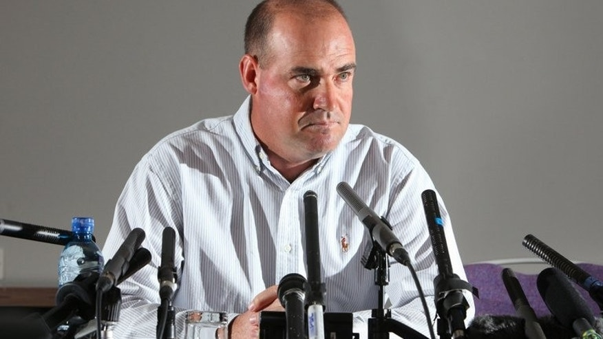 Sacked Australian cricket coach Mickey Arthur speaks to journalists during a press conference in Bristol, southwest England, on June 24, 2013. Arthur refused to blame the players after he was sacked as Australia's head coach just 16 days before the start of the Ashes series in England.