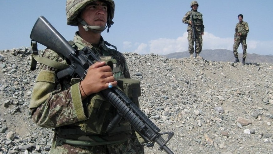 Afghan soldiers on patrol near Jalalabad, on September 28, 2012. US envoy James Dobbins is set for talks with Afghan President Hamid Karzai in Kabul, as Washington works to put peace efforts back on track after a dispute over the rebels' new office in Qatar.