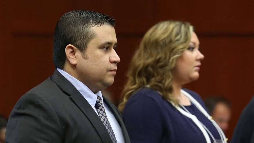 George Zimmerman arrives with his wife Shellie, on the 11th day of his trial in Seminole circuit court June 24, 2013 in Sanford, Florida.