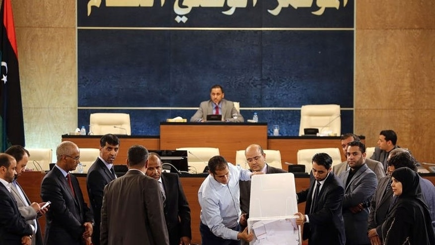 Libya's General National Congress members attend the first round of voting to elect the new congress president on June 25, 2013 in Tripoli.