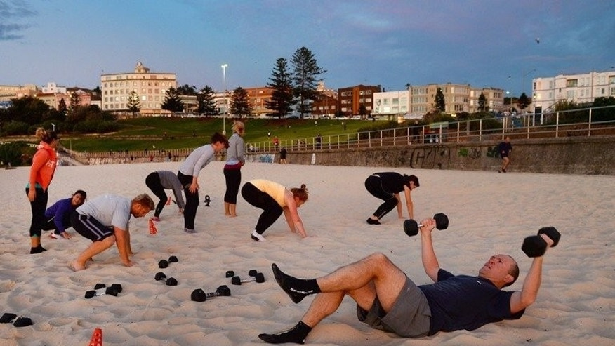 Boot camp enthusiasts work out on Sydney's Bondi Beach on May 21, 2013. Boot camps have sprung up around Australia, while other physical challenges such as Tough Mudder have also proven popular.