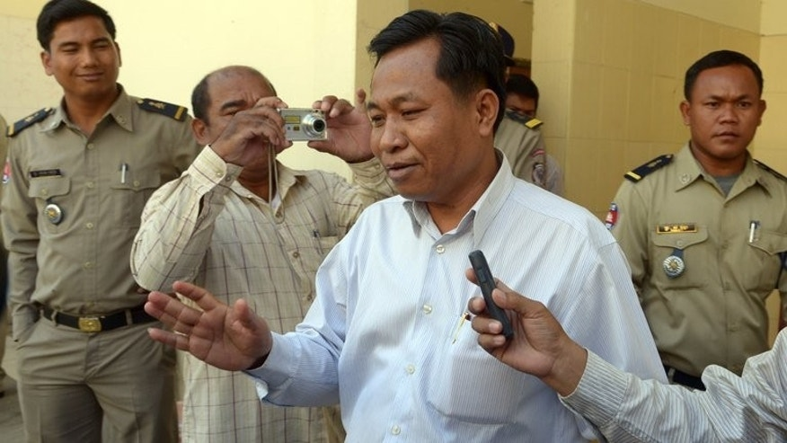 This photo show former governor of Bavet City, Chhuk Bundith (C), pictured near appeals court in Phnom Penh, on February 27, 2013. A Cambodian court sentenced Bundith to 18 months in prison for shooting three female workers at a factory supplying sportswear giant Puma, a judge said on Tuesday.