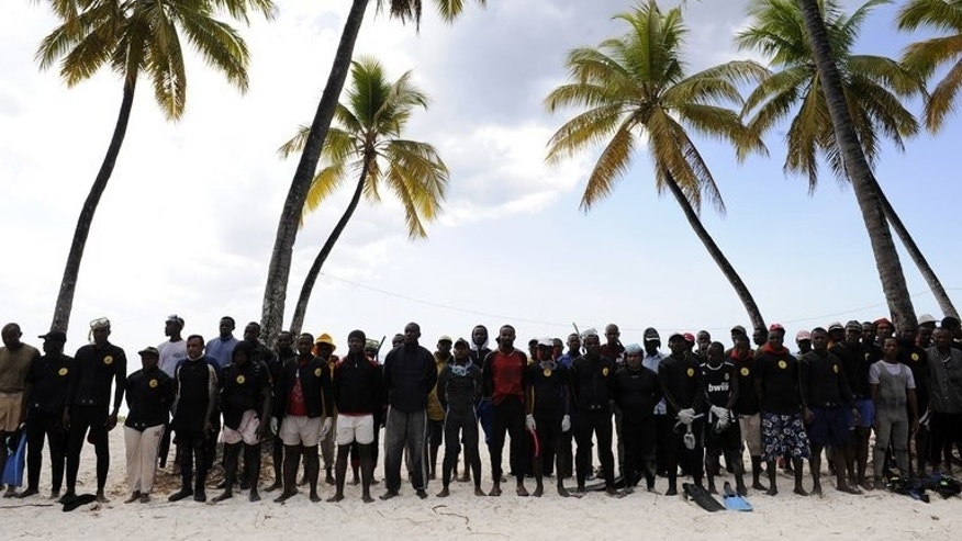 Divers wait on July 1, 2009, by a temporary emergency camp after a plane crash off the northern coast of the Comoros that killed 152 people. A final report into the 2009 crash has found the pilots were to blame for the accident, an investigative commission said on Tuesday.