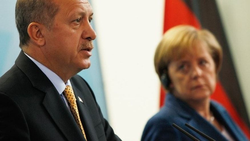 Picture taken on October 9, 2010 shows German Chancellor Angela Merkel and Turkish Prime Minister Recep Tayyip Erdogan addressing a press conference at the chancellory in Berlin. European Union ministers agreed Tuesday to reopen Turkey's accession talks despite reticence from Germany and others over Ankara's tough crackdown on protests.