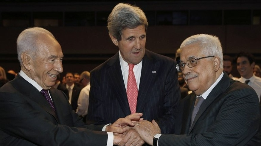 US Secretary of State John Kerry (C) shakes hands with Israeli President Shimon Peres (L) and Palestinian President Mahmud Abbas in Jordan, on May 26, 2013. Just days before Kerry returns to push for a resumption of direct peace talks, a growing number of Israeli ministers are openly expressing their opposition to the two-state solution.