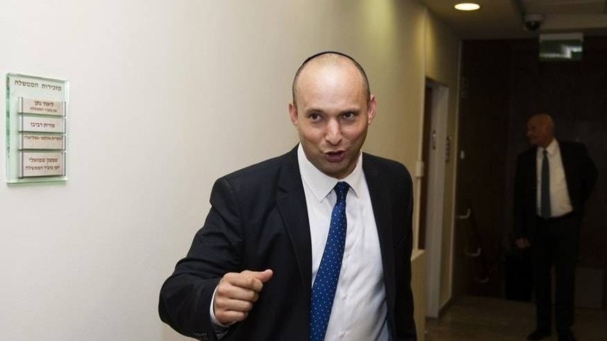 "Naftali Bennett, who heads the far-right Jewish Home party, is pictured in Jerusalem on March 18, 2013. Earlier this month, Bennett drew an analogy in which he suggested that for Israel, the Palestinian issue was akin to having ""shrapnel in the buttocks."""