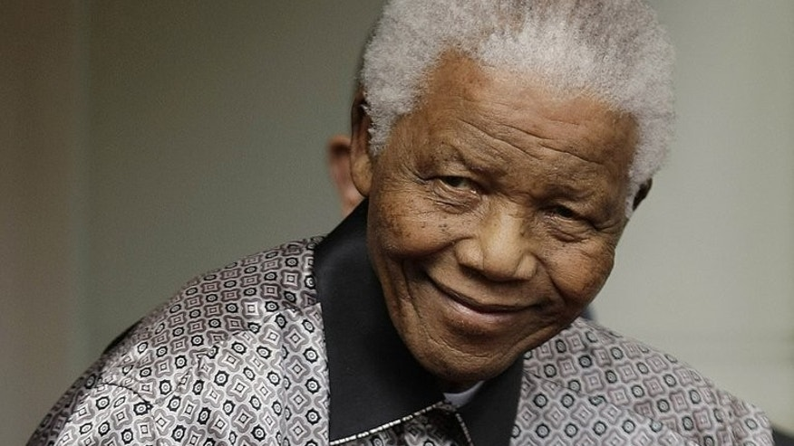 "Former South African president Nelson Mandela pictured in London on June 26, 2008. Mandela remains in a critical condition in hospital in Pretoria, granddaughter Ndileka Mandela told AFP Tuesday, adding that the anti-apartheid icon was ""stable""."