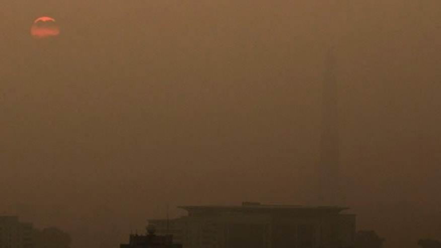 June 25, 2013: The Juche Tower stands in fog at sunrise in Pyongyang, North Korea.