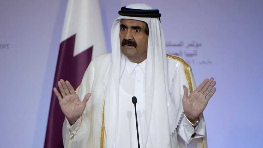The emir of Qatar, Sheikh Hamad bin Khalifa al-Thani, speaks during a press conference on September 1, 2011. The succession of power in Qatar is not expected to disrupt the tiny Gulf state's rising international political influence or its role as an economic powerhouse with a global reach, analysts say.