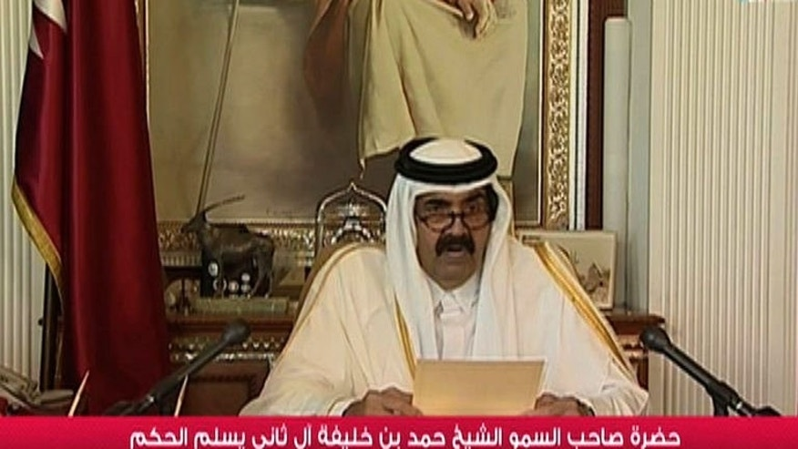 "An image grab taken from Qatar TV shows Sheikh Hamad bin Khalifa al-Thani delivering a speech in Doha on June 25, 2013. His decision to abdicate marks the ""beginning of a new era in which a young leadership will hold the banner"", he said."