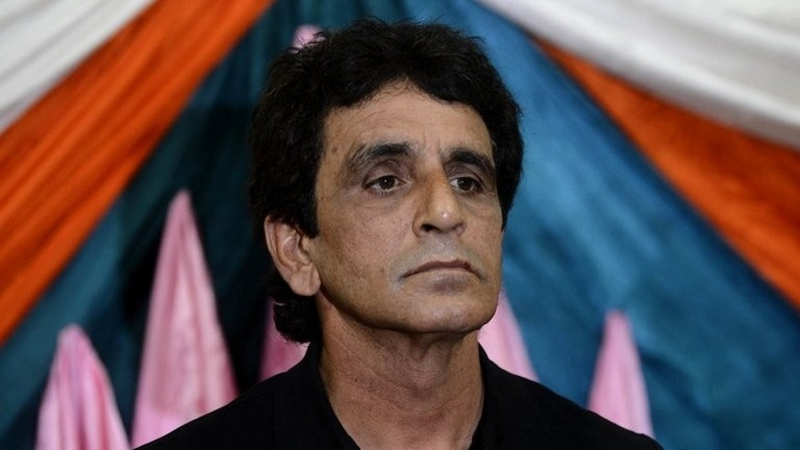 Pakistani umpire Asad Rauf speaks during a press conference in Lahore on May 29, 2013. Rauf and Billy Bowden have both been dropped from the International Cricket Council's panel of elite umpires, the global governing body announced Tuesday.