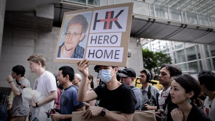 Protesters march to the US consulate in Hong Kong during a protest in support of Edward Snowden, on June 15, 2013. Snowden's dramatic flight from Hong Kong on Sunday reportedly came about after he received assurances from the local government -- backed by Beijing -- that he would be free to go, provoking a stinging response from irate officials in Washington.