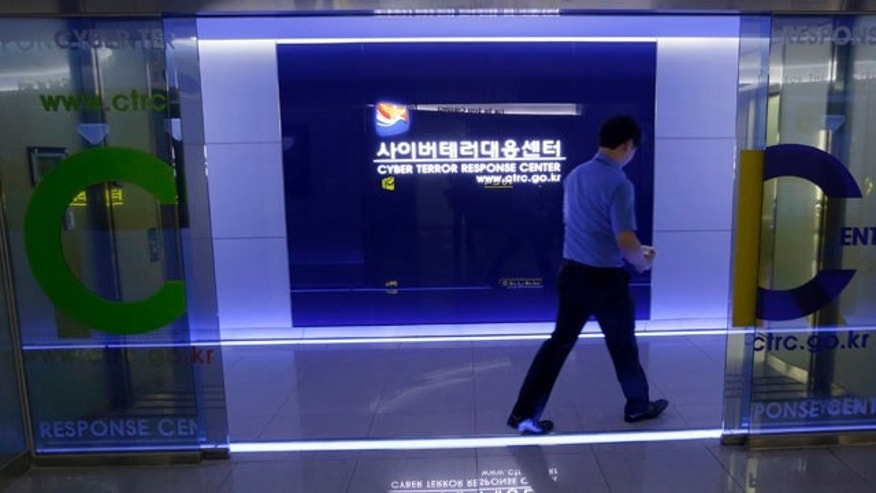 June 25, 2013: A man walks by a gate at Cyber Terror Response Center of National Police Agency in Seoul, South Korea.