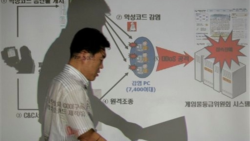 A South Korean police officer of the National Police Agency shows how hacker attacks, believed to have come from North Korea, struck the agency's headquarters in Seoul.