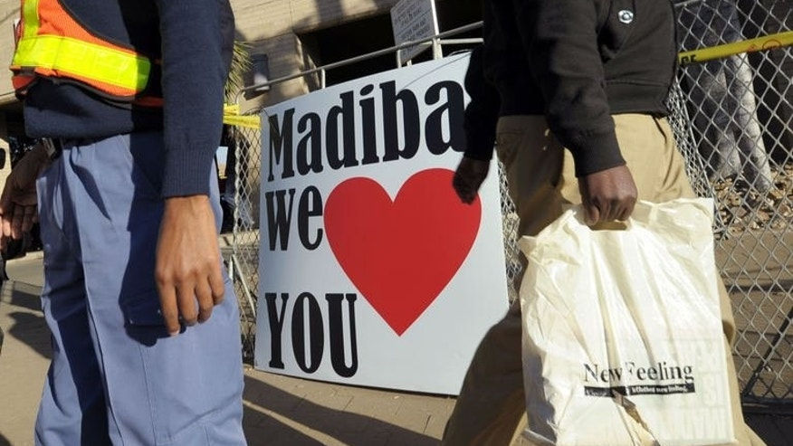 "A sign wishing former South African president Nelson Mandela well hangs outside of the Medi Clinic Heart Hospital in Pretoria where Mandela is receiving treatment, on June 25, 2013. South African traders on Tuesday dismissed fears of a ""Mandela crash"" when the icon dies, after steep selloffs hit the rand and Africa's largest stock exchange."