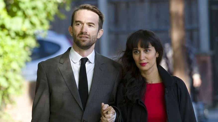 Australian Trenton Oldfield (L) and his wife Deepa Naik arrive at Isleworth Crown Court in west London on September 25, 2012 during his trial. Oldfield, who was jailed for disrupting Britain's annual university Boat Race on April 7 2012, has been told to leave the country despite the fact his British wife is pregnant, officials said Tuesday.